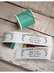 """This beautifully woven design is perfect for adding a special little something extra to your next craft project. Each label is precut with pinked edging, is washable, and has a woven heading that reads """"Made just for you with love from"""", with room for you to add your name. Each label is 2 1/4"""" x 7/8"""".Important: Please type desired name (you have up to 18 letter/spaces) in the Required Information field of the shopping cart when completing your Internet order. Drop shipped from our supplier. Please allow 3-4 weeks for delivery. Shipments available to the 48 contiguous states only.Please note, due to the current weather situation, these labels may take longer to receive than normal."""
